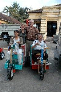 Dr. Dale Dykema and his wife Cathy with new owners of P.E.T. mobility carts near Hue, Vietnam