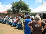 Kenyans with various leg disabilities cue up for instruction and seat  adjustments before departing with the Gift of Mobility. In total 145 PET  carts were distributed to those in need.