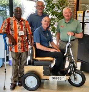 L to R: Ibrahim Bangura, Von Driggs, Scott Walters (seated on PET #50,000), Jim Conn