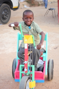 Mncedisi tries out his new PET cart which will take him to school.