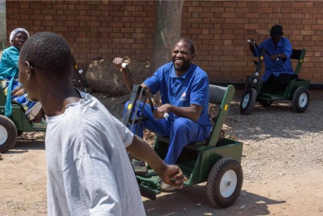 Emmanuel Chilufya on his trike, which gives him mobility on the rough Zambian terrain. (Courtesy: Rick Shaw, International Pictures of the Year)