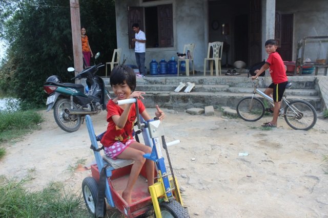 Ho Thi Huong, 11 years old, Cerebral Palsy. She also is very glad to have the cart.
