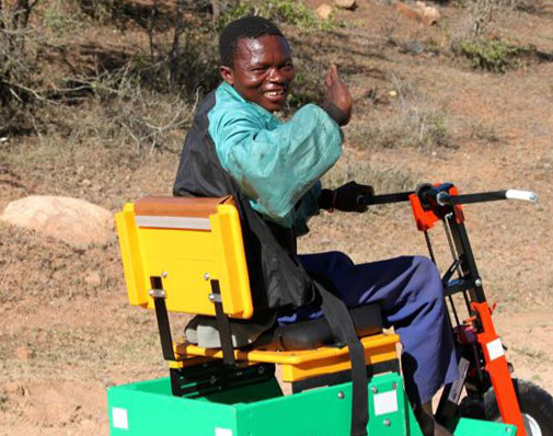 Thathel is all smiles on his new Mobility Cart